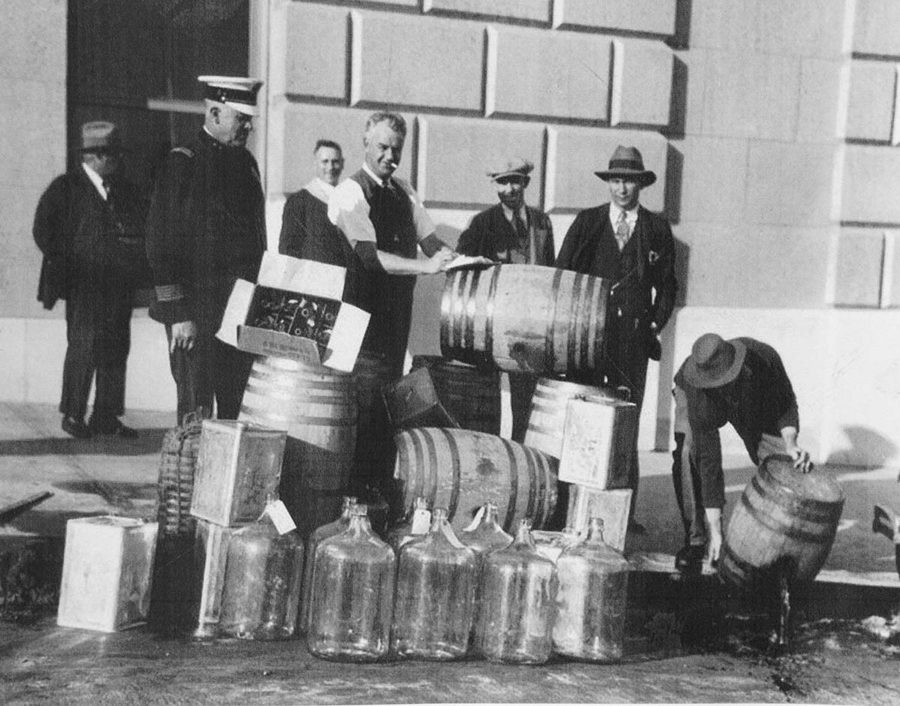 Historical photo of Prohibition wine being poured into the gutter