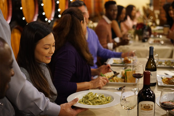 Close up of woman being served pasta at winery event