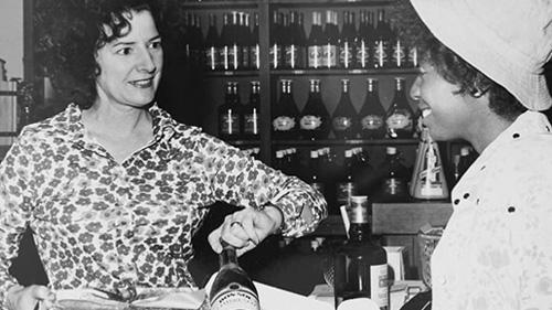 Historic photo of Maddalena selling wine